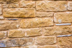 Background wall made of stone. Fragment of a wall from a chipped stone Stock Image