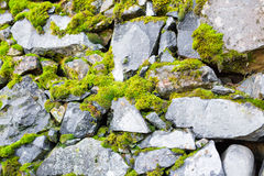 Background wall made of stone. Fragment of a wall from a chipped stone Royalty Free Stock Photography