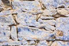 Background wall made of stone. Fragment of a wall from a chipped stone Stock Photos