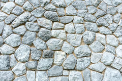 Background wall made of stones held together with cement Stock Photos