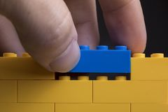 Background wall made of toy construction brick blocks stock photos