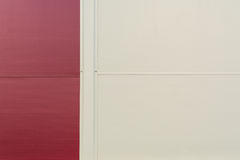 Background of a wall of red and beige ribbed metal profile Royalty Free Stock Photography