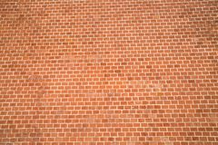 The background of the wall of red brick Backgrounds textures for graphic design. Photo Wallpaper royalty free stock image