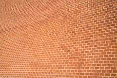 The background of the wall of red brick with perspective stock photo