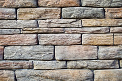 Background of wall with rough solid stone Royalty Free Stock Photos