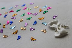 Background wallpaper ribbon dragonfly colorful gems crystal rhinestone glitter texture. Fabric white cute royalty free stock photos