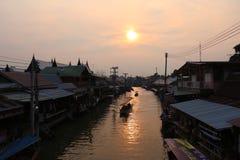 Background wallpaper. Sunset at amphawa floating market stock images