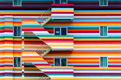 Background walls of bright colored buildings with fire escape / bright colored buildings royalty free stock photography