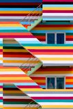 Background walls of bright colored buildings with fire escape / bright colored buildings royalty free stock photo