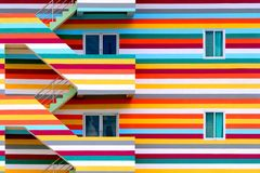 Background walls of bright colored buildings with fire escape / bright colored buildings. / doors and windows on the side of the building stock photography