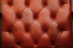 The background is a warm dark orange red leather furniture, door. Seamless leather texture. The seamless red leather texture.  Luxury  leather close-up Stock Photos