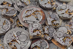 Background - watches. Background of old watches mechanisms with gears Stock Photos