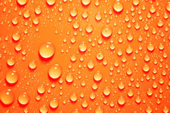 Background of water big and small drops. On color backdrop Royalty Free Stock Photos
