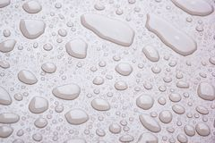 Background of water droplet on the surface in pink color Stock Image