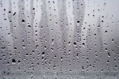 Background with water drops on the glass. Water vapor on the win Royalty Free Stock Images