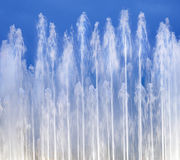 Fountain on blue sky Royalty Free Stock Photo