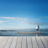 Background on water. Landscape of a wooden jetty overlooking the sea with a sunny background Royalty Free Stock Photo