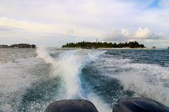 Background water surface behind of fast moving motor boat. Against the background of a tropical island Royalty Free Stock Photo