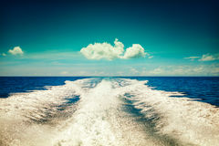 Background water surface behind of fast moving motor boat in vintage retro style. Vintage sky background - Vintage Filter Stock Photography