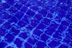 Background of water in the swimming pool with a wave Stock Images