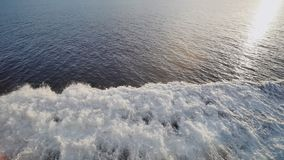 Background of water trail foaming behind a ferry boat. stock footage