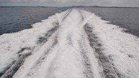 Background of water trail foaming behind a ferry boat. Background of water trail foaming behind a ferry boat stock video footage