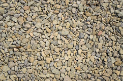 Background of waterworn pebbles Stock Image