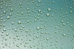 Background of watrer drops on surface. Kunming Stock Photos