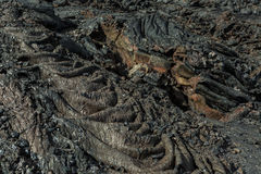 Background of the waves frozen lava field at Tolbachik volcano, after eruption in 2012, Klyuchevskaya Group of Volcanoes. Background of the waves frozen lava royalty free stock images