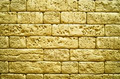Background of a weathered brick of golden color.  royalty free stock photos