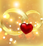 Background with wedding rings and heart Royalty Free Stock Images
