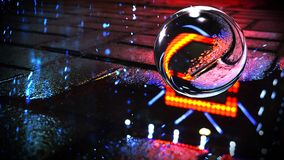 Background of wet asphalt with neon light. Reflection of neon lights in puddles, bright colors, glass ball. Neon night city royalty free stock images