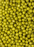 Background of wet green peas Royalty Free Stock Photos