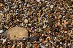 Background small bright pebble Stock Photos