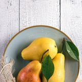 Background with wet yellow pears royalty free stock image