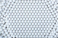 Background of white balls. airsoft 6mm. Royalty Free Stock Photo