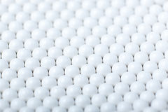 Background of white balls. airsoft 6mm bb. Royalty Free Stock Images