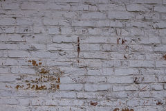 Background white brick wall in a retro style. Old white brick wall and underneath a red Royalty Free Stock Photo