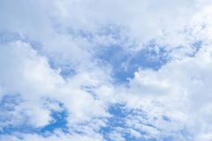 Background of white clouds in deep blue sky Stock Images