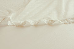 Background of white delicate lace fabric Stock Image