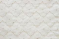 Background of white embroidered fabrics Royalty Free Stock Photo