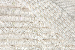 Background of white knitted blanket folded in layers Stock Photos