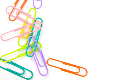 Paper and multi-colored paper clips. Background of white paper and multi-colored paper clips Stock Photography