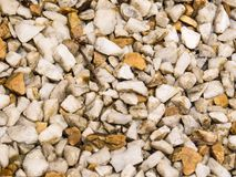 Background of white pebbles, and light browns. Close up view Background of white pebbles, and light brown, wet after summer rain Royalty Free Stock Images