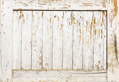 Background of white, peeling paint on an old wall Stock Image