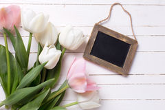 Background with white and pink flowers and empty blackboard for Stock Image