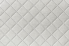 Background of white textile texture with diamond pattern Royalty Free Stock Photos