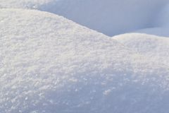 The background is white. The texture of the brilliant snow for the New Year`s postcard stock photo