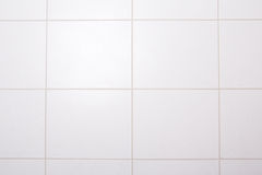 Background of white tiled wall in bath royalty free stock image
