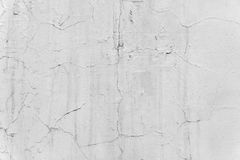 The background is a white wall with cracks in the plaster. The background is a white wall with cracks Royalty Free Stock Photos